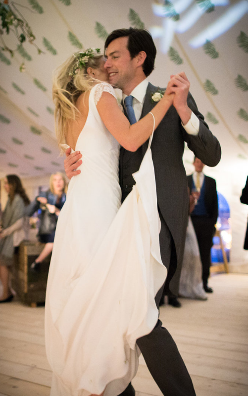 Carly wears a wedding dress by Halfpenny London