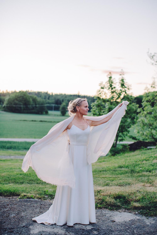 Karin wears a wedding dress by Halfpenny London