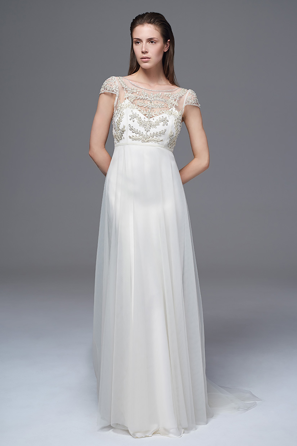 THE ELAINE DRESS WITH A HAND BEADED AND EMBROIDERED BODICE WITH A LOW V BACK WORN WITH THE CLASSIC IRIS SLIP. BRIDAL WEDDING DRESS BY HALFPENNY LONDON