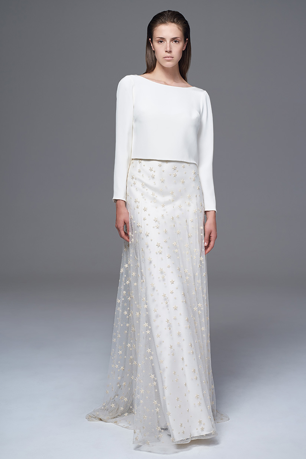 THE LAURA DRAPED AND LONG SLEEVED CREPE TOP WORN WITH THE SHEER TULLE AND EMBROIDERED STAR SKIRT AND CLASSIC IRIS SLIP. BRIDAL WEDDING DRESS BY HALFPENNY LONDON