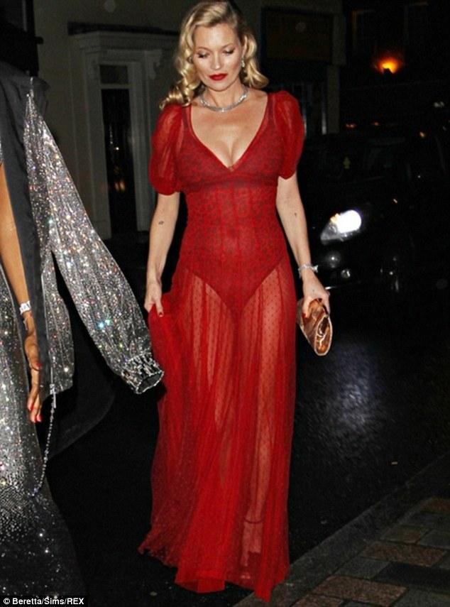 Kate Moss wears a dress by Halfpenny London