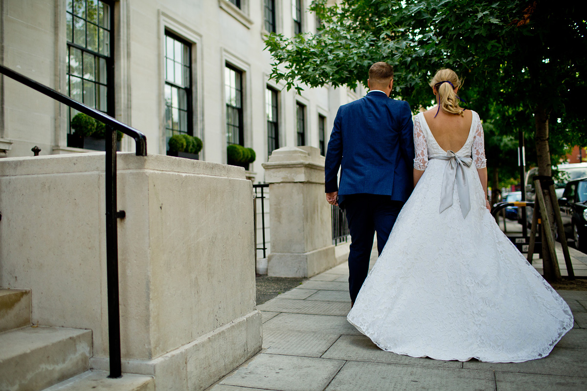 Beautiful bride Melissa wears a wedding dress by halfpenny London