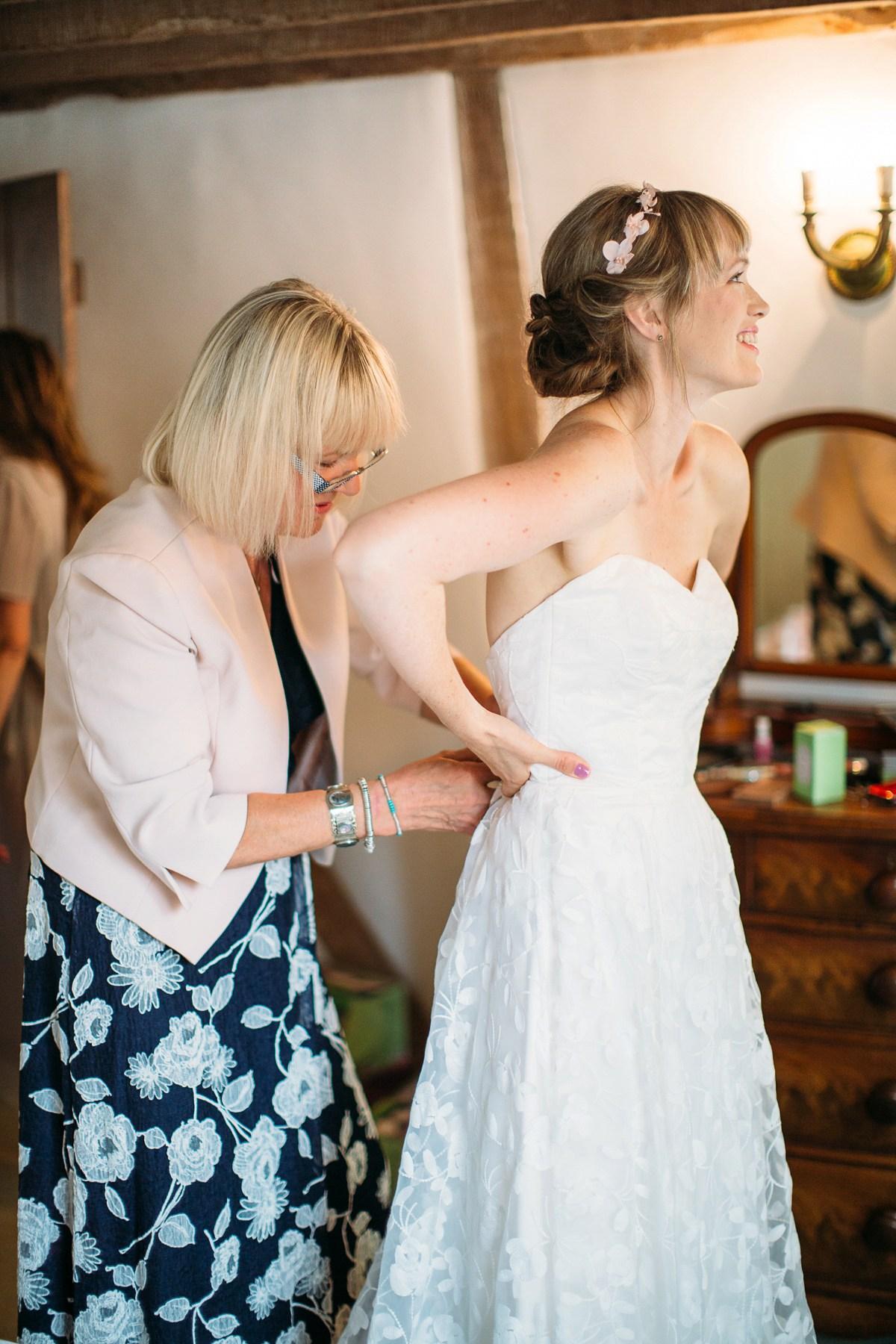 Beautiful bride Eleanor wears a wedding dress by Halfpenny London