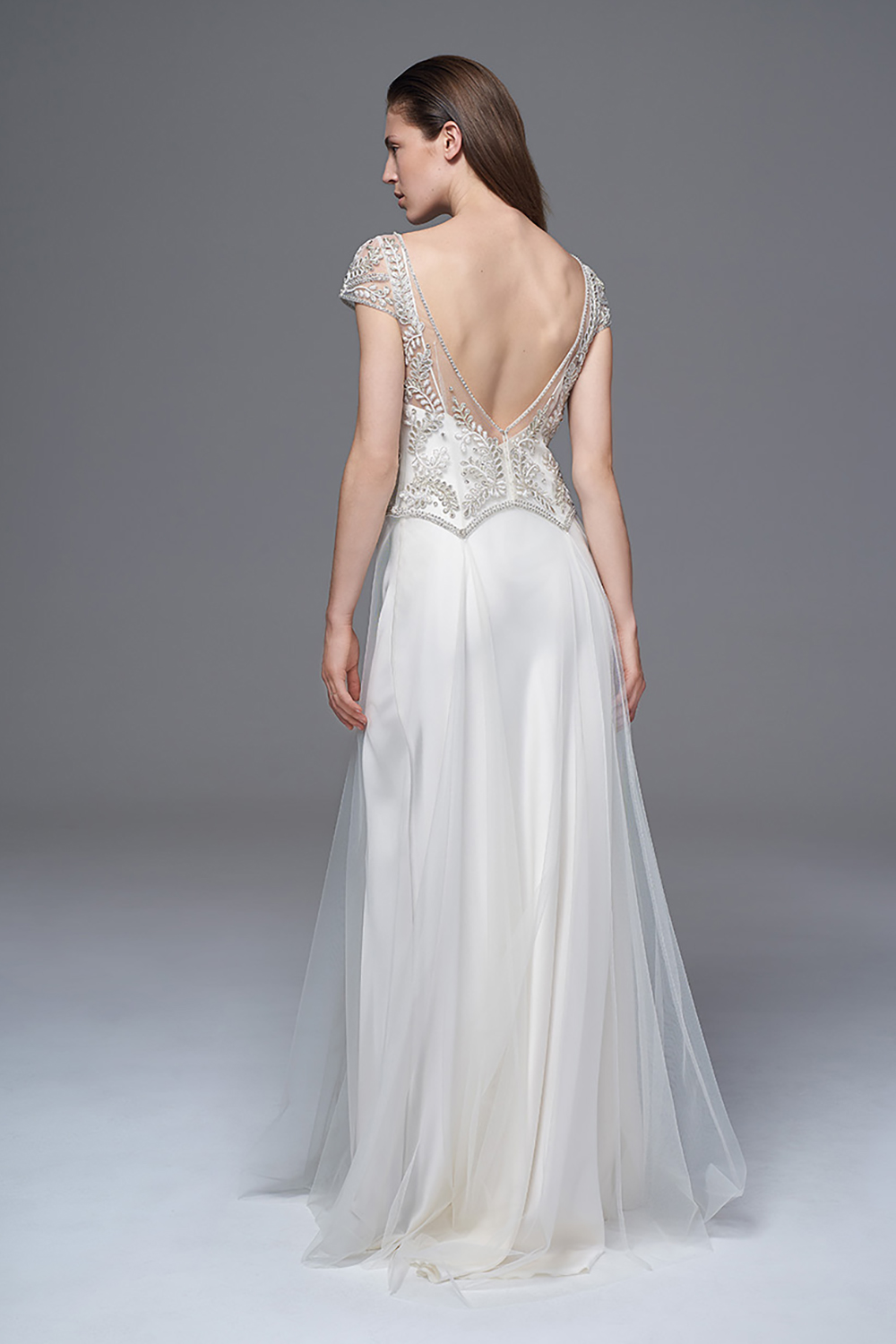 THE MARIANNE HAND BEADED AND EMBROIDERED DRESS WITH A LOW V BACK AND DROP WAIST WORN WITH THE CLASSIC IRIS SLIP. BRIDAL WEDDING DRESS BY HALFPENNY LONDON