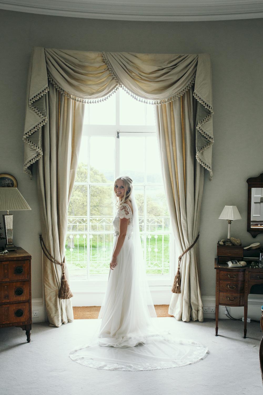Beautiful bride Jess wore a wedding dress by Halfpenny London