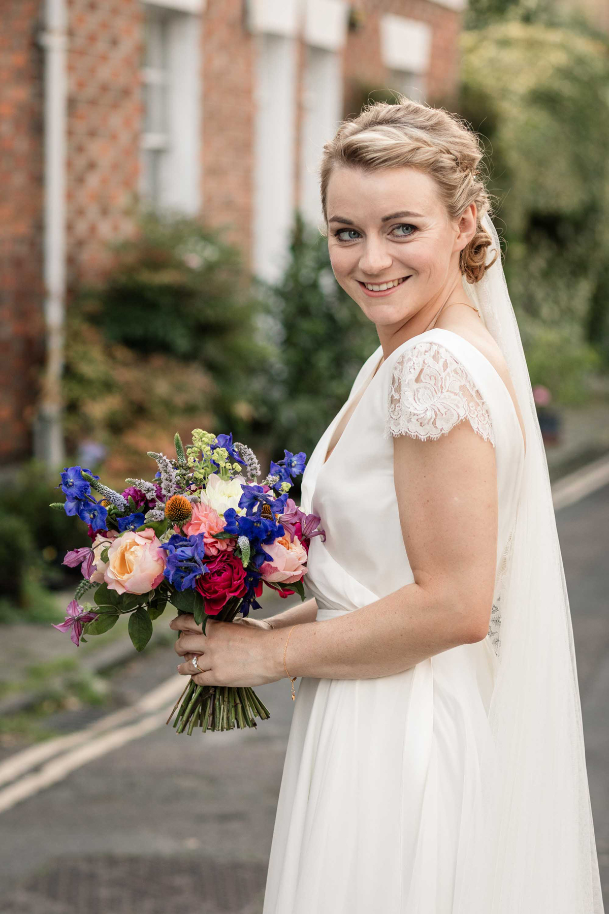 Beautiful bride Laura wore a wedding dress by Halfpenny London