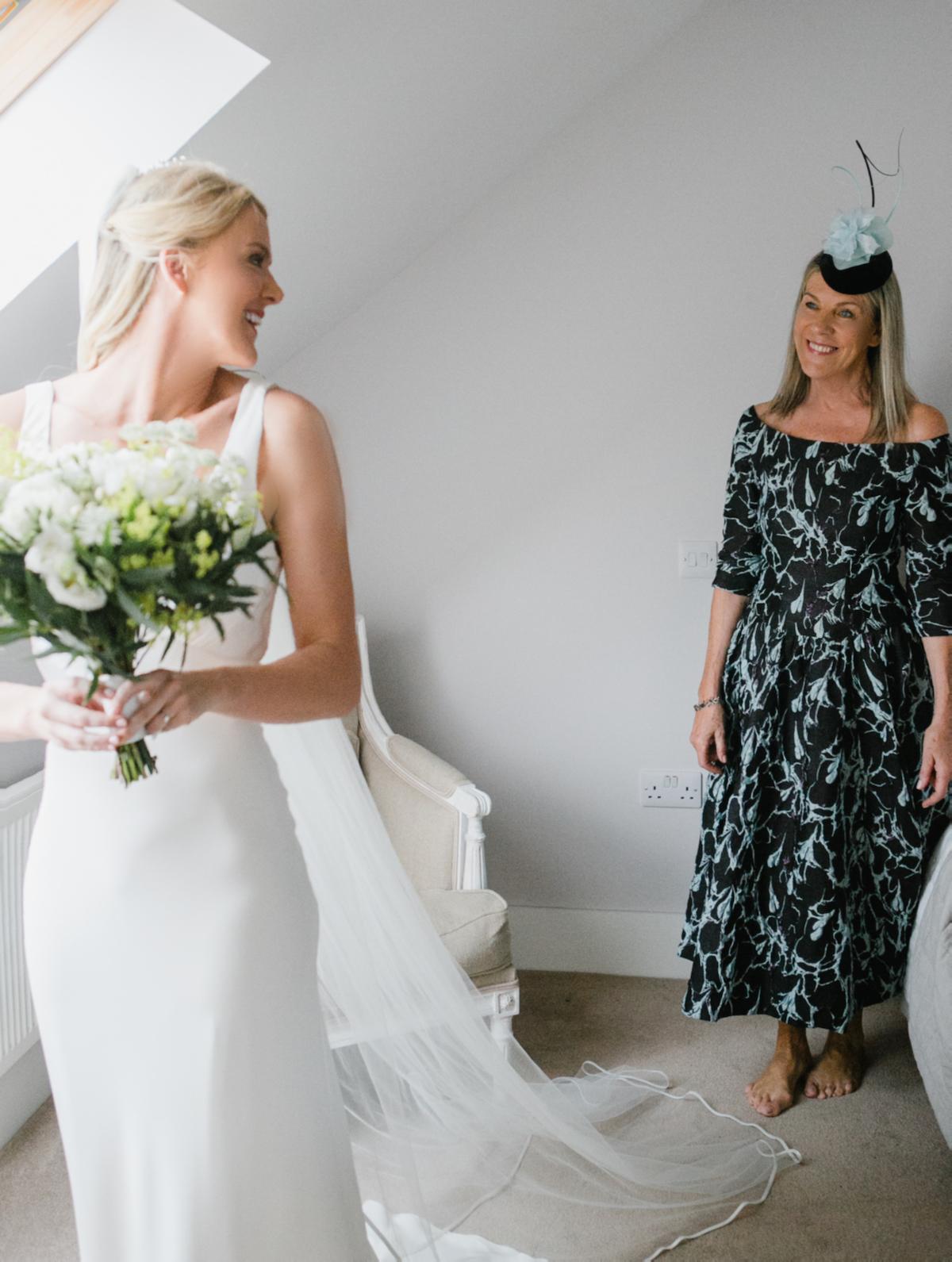 Beautiful bride Emily wore a wedding dress by Halfpenny London