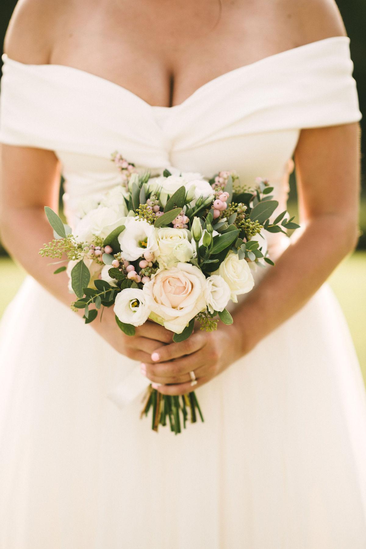 Beautiful bride Lilli wore a wedding dress by Halfpenny London