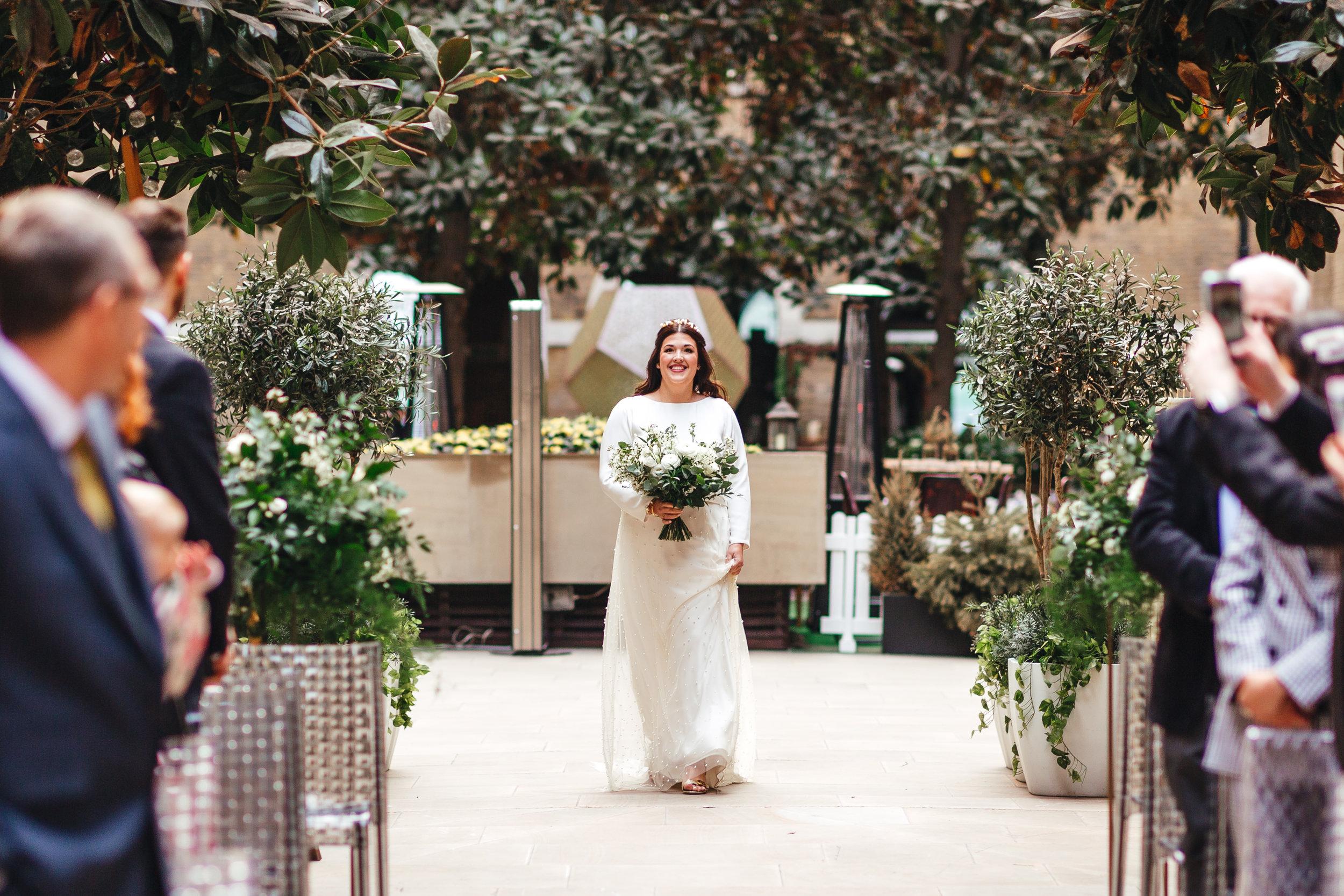 Beautiful bride Sarah wore a wedding dress by Halfpenny London