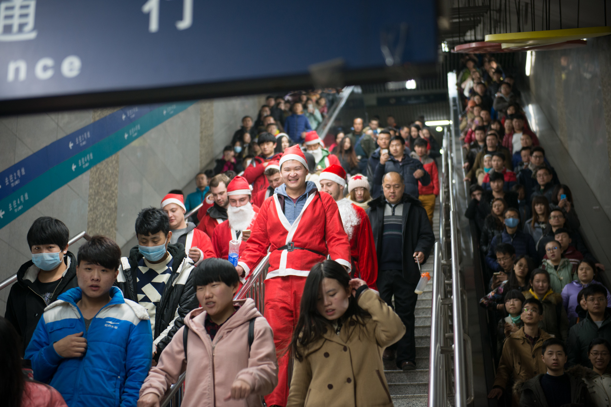 A wave of Santas heads to the Gulou (Drum tower) region of Beijing, on the Line 2 Subway