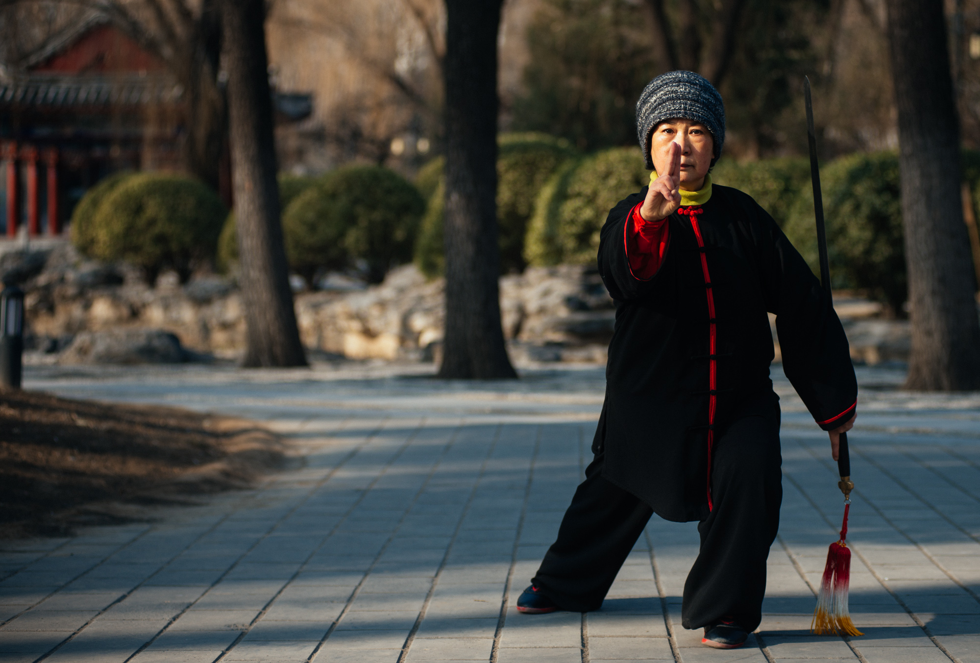Woman practices  Taijijian  in the park.