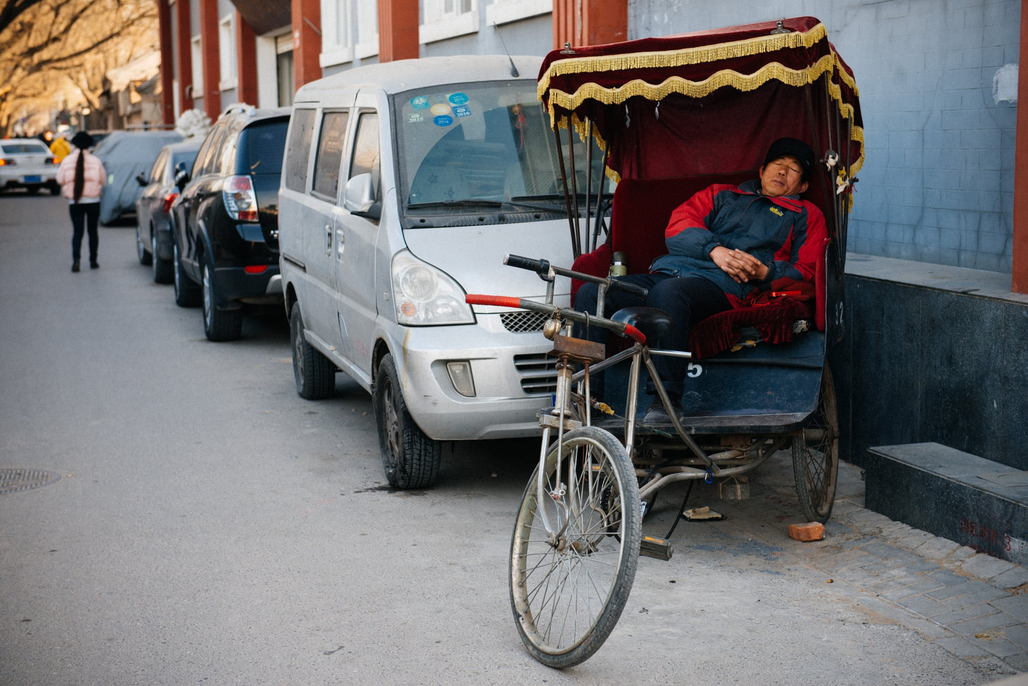 In the hutongs, the small alleyways in historical Beijing, it very common for tourists to go on rickshaw rides and get to know this neighborhood. Today was a slow day, so this guy was taking a nap.Careful when setting a price, they do try to overcharge foreigners and sometimes try to charge a different amount from what was settled in the beginning.
