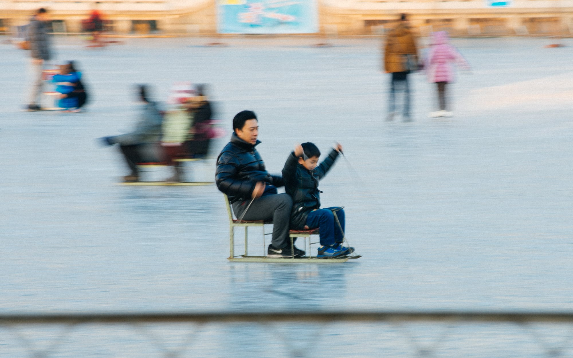 This kid was having so much fun trying to push his chair-skate, but actually the dad in the back was doing all the work.