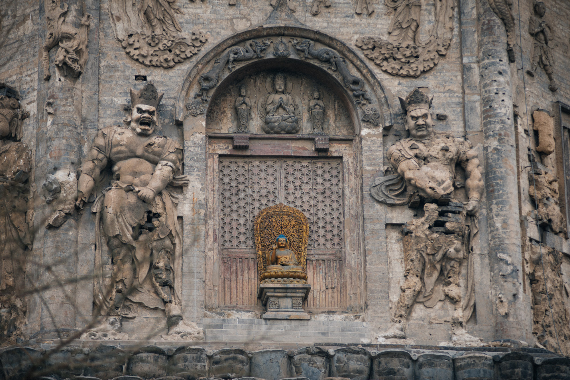 The statues on the sides of the temple, although severely damaged, are believed to be original, having survived the great Tangshan earthquake of 1974 and the Cultural Revolution, when most relics of this and other temples around China were destroyed.