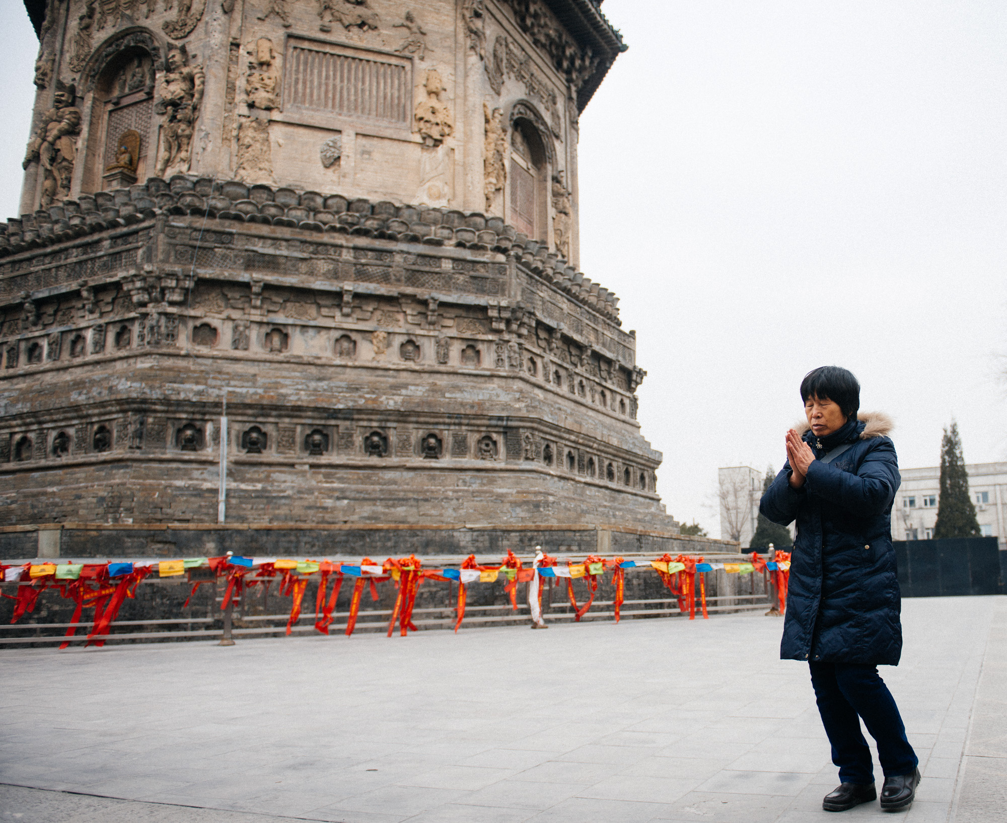I observed many people would walk around the pagoda clockwise, while praying. Several would just walk while whispering, some would stop in front of each door and bow, and others would just be quiet in their worship.