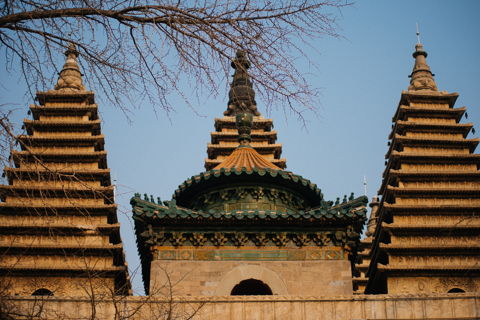The temple has five pagodas on the top, associated to each of the five Dhyani Buddhas. In the front, with the green tiles, is a Chinese style construction, adding to the uniqueness of this building.