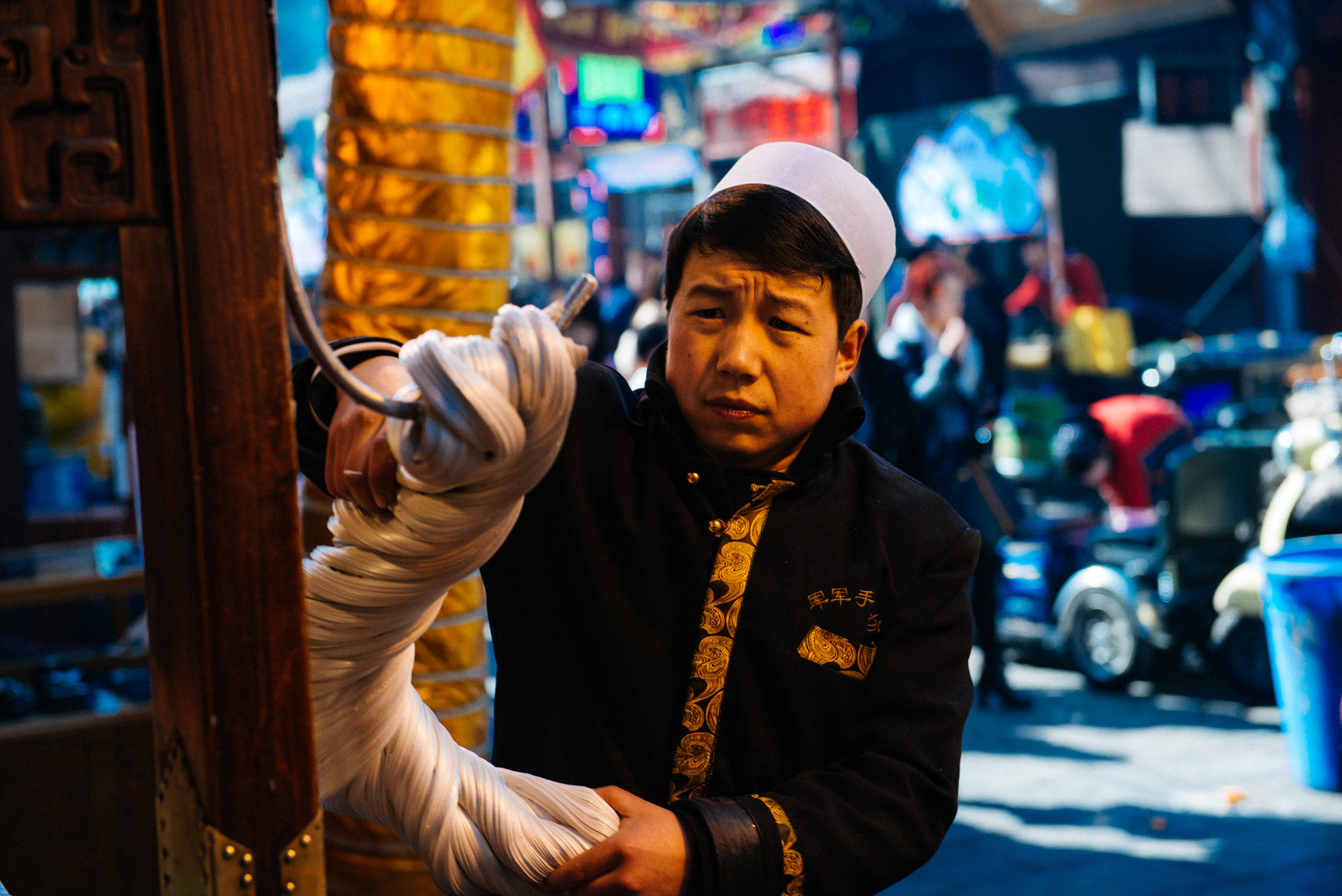 Several stores make candy on the streets where candy makers pull the sweet hanging from a hook making a popular attraction for tourists.