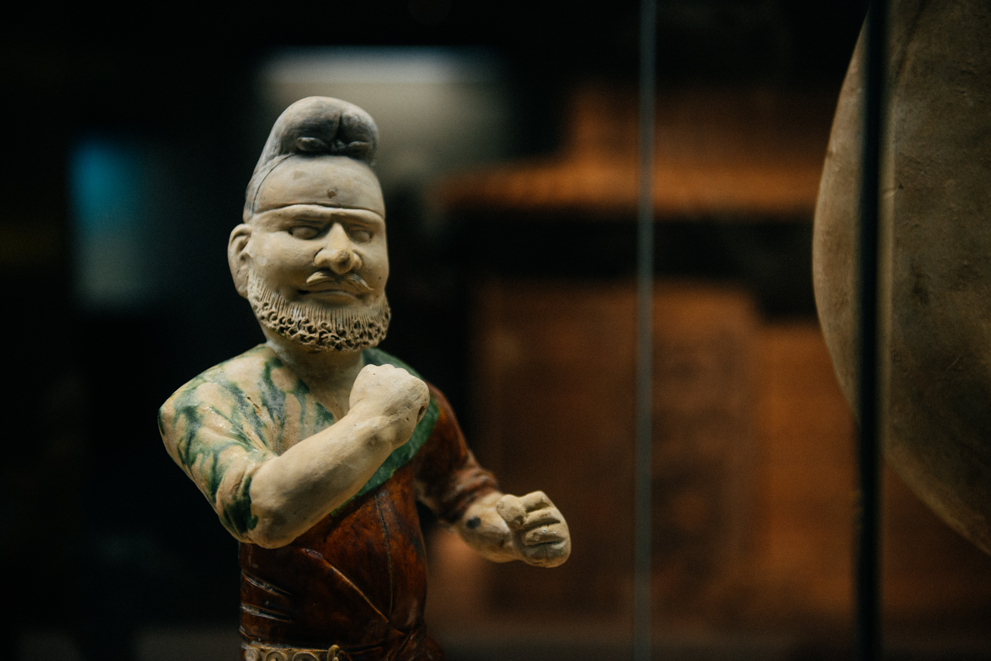 """I call this one """"come fight with papa smurf"""". This is a depiction of a foreigner from ancient China. """"The non-asian have big noses, small faces and beards"""", says a friend of mine."""