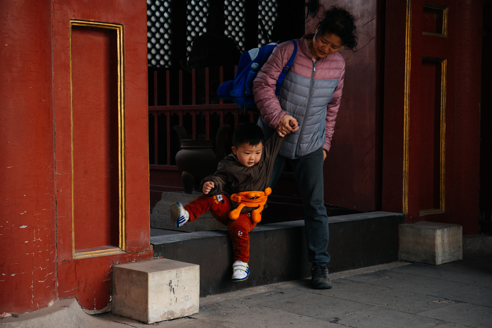 In the entrance of many temples and palaces in China, there is an elevation. Legend says this is to keep spirits from coming in. It also works with toddlers.