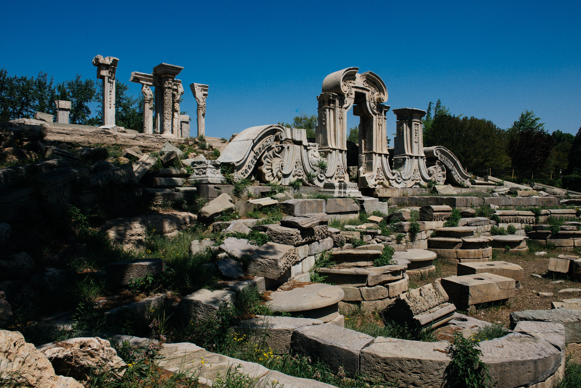 """The so-called """"European-style palace"""" was an exotic building with its columns and round shapes, very different from the traditional local architecture. These are the most famous ruins of this site."""