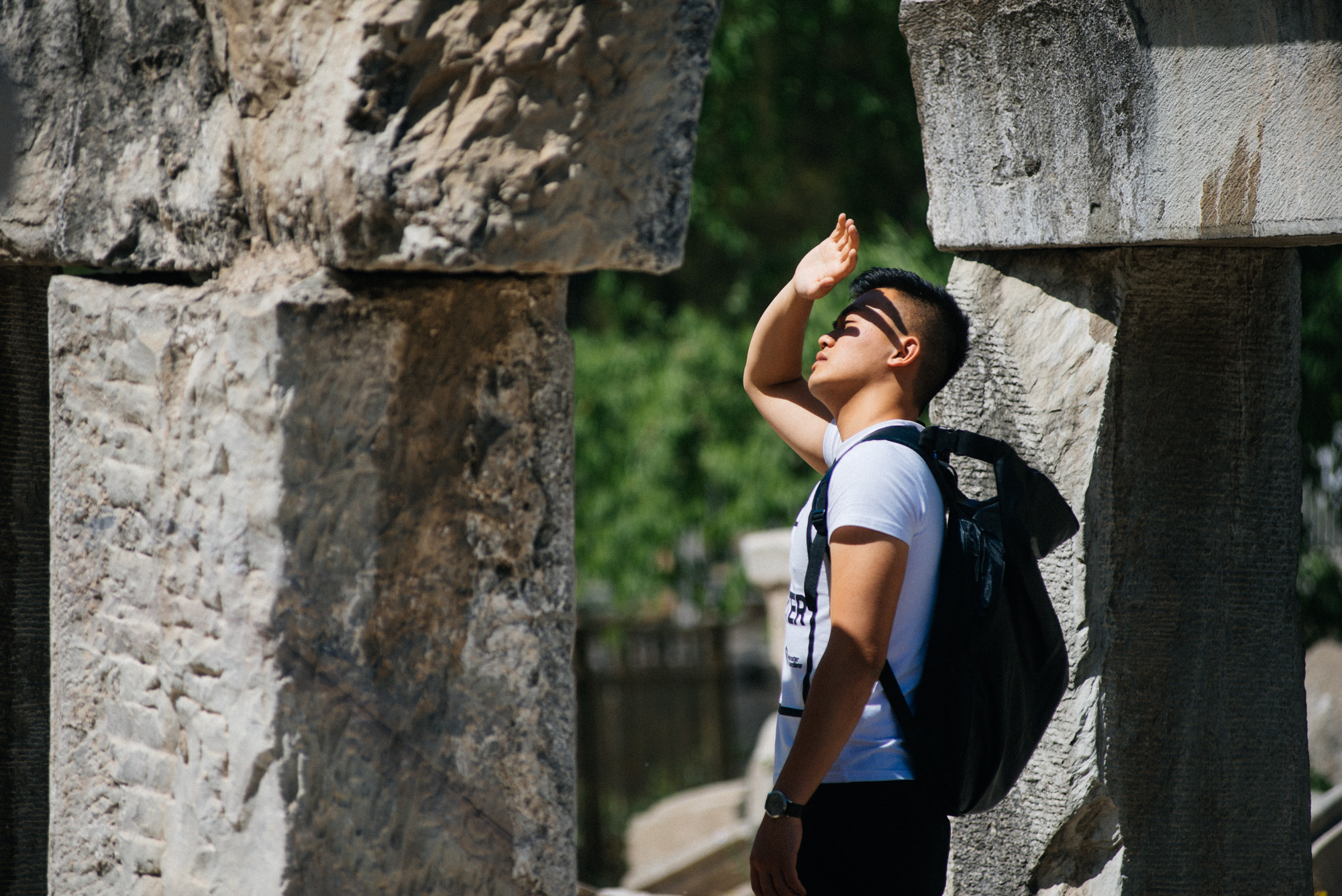 On a hot spring day last week, a tourist looks at ruins that have been stacked up in a seemingly random fashion. It's like a modern day Stonehenge.