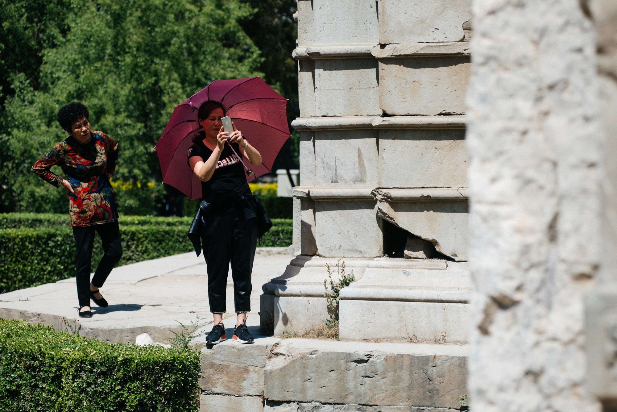 In China, it's very common to see people, specially women, with umbrellas to protect themselves from the sun.