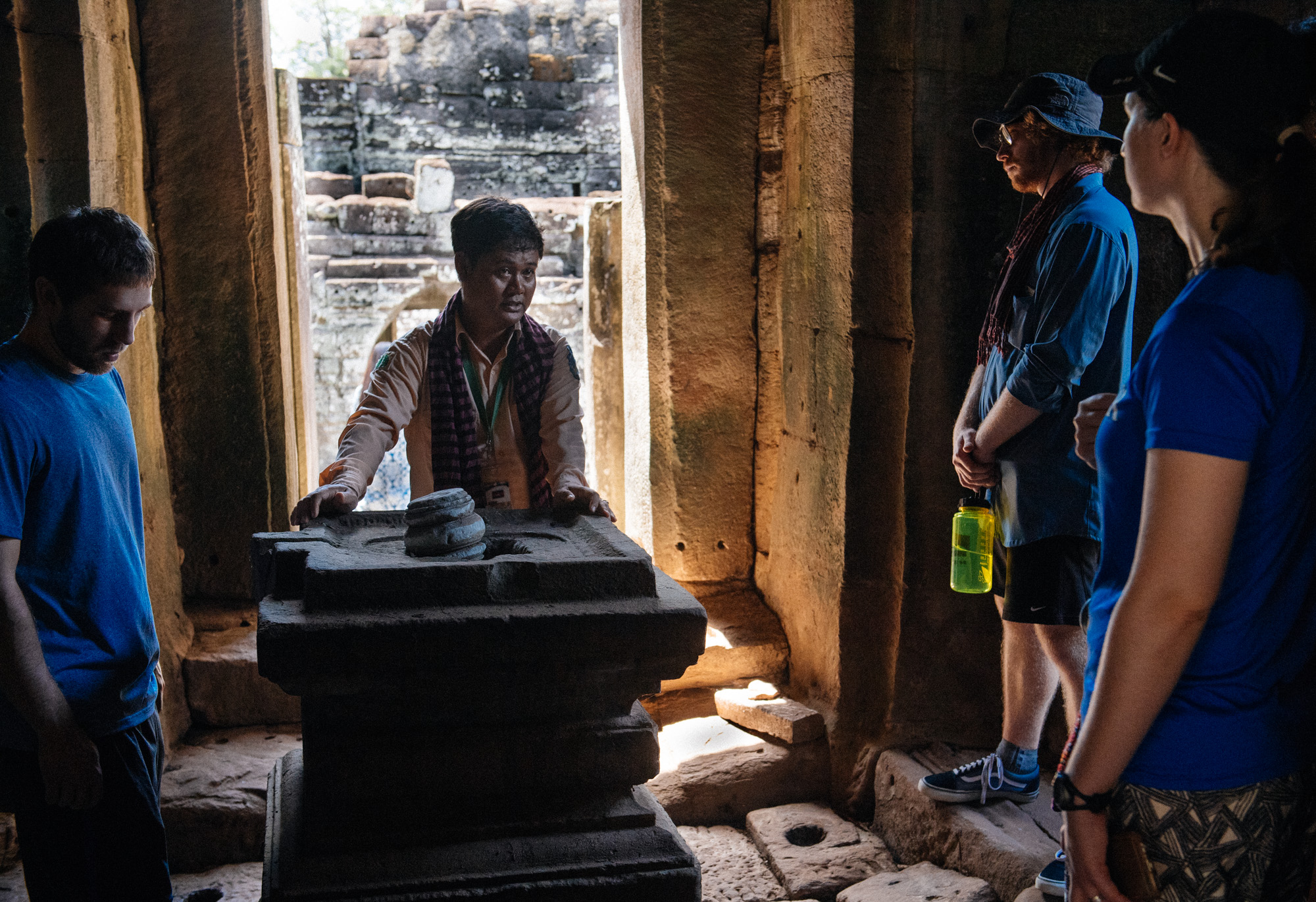 Tour guide explains in Italian to tourists how the  Lingam  structures represent a phallus and womb. It is an abstract representation of the Hindu god Shiva. These sculptures can be found in almost every temple in Angkor.