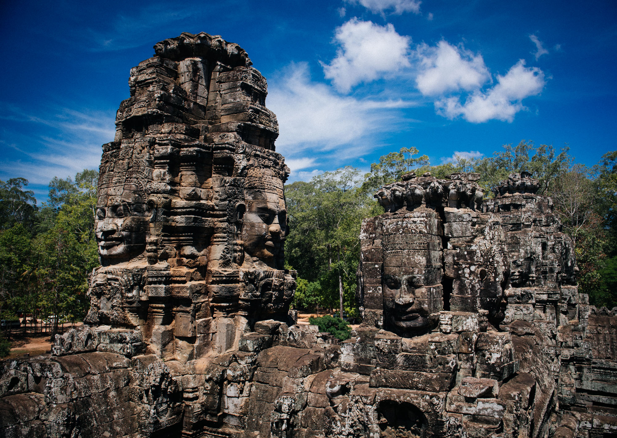 The Bayon has around 216 faces thought by some scholars to be the image of king Jayavarman VII himself, while others believe them to be the bodhisattva  Lokesvara .