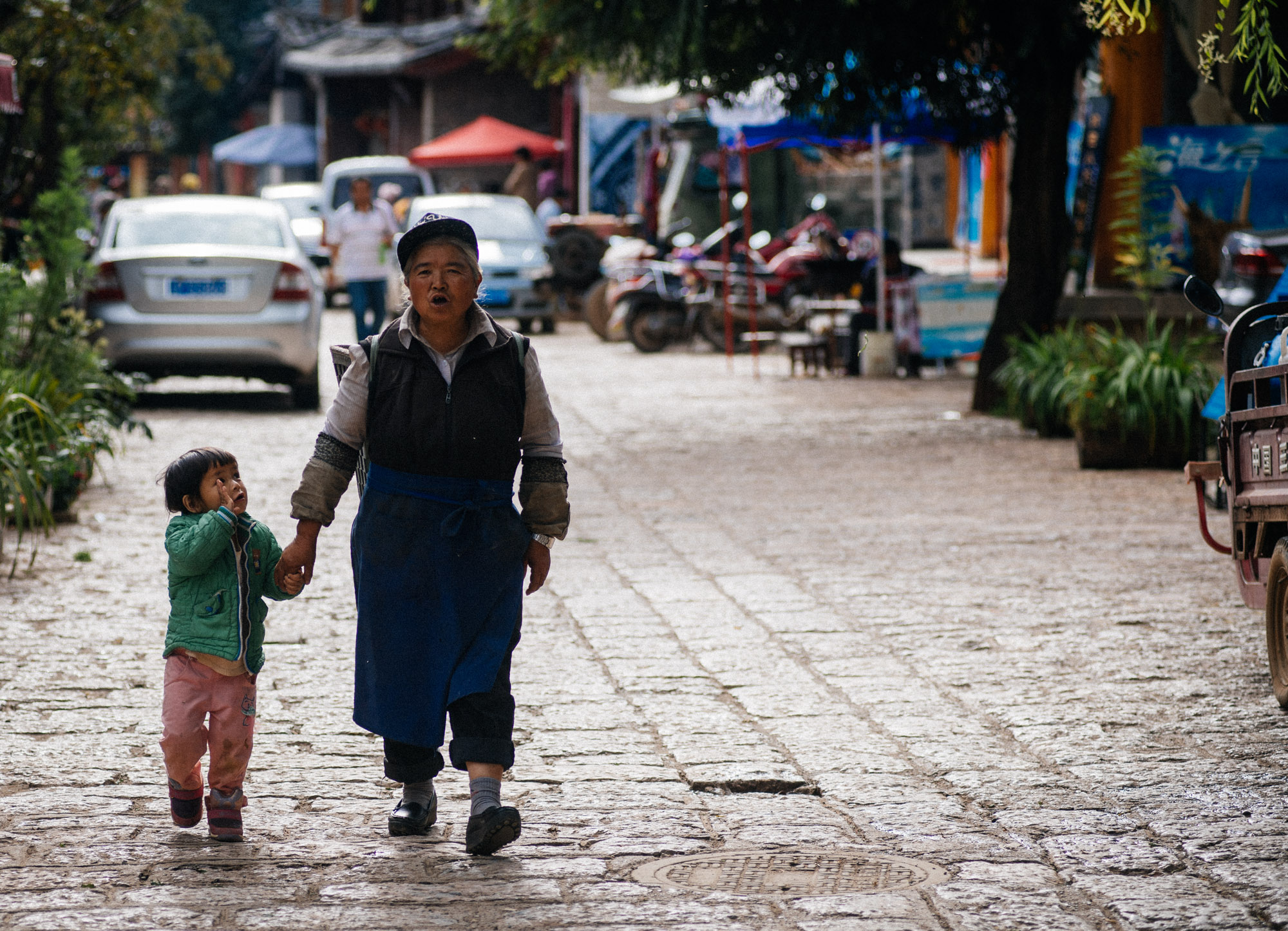 As most places in China, grandmothers take care of children while the parents go to bigger cities for better jobs and send money home.