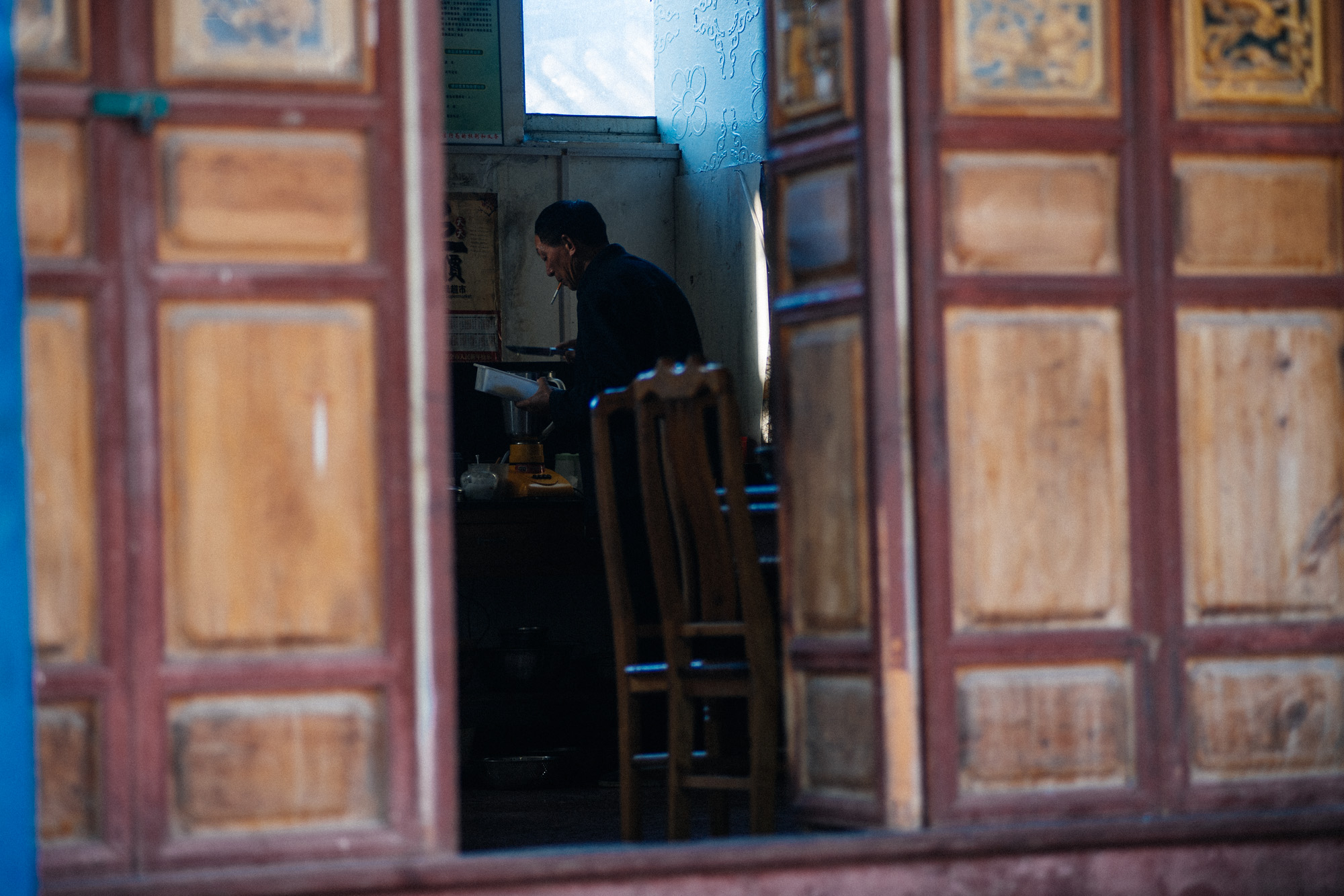 A man prepares food for a large group of monks.
