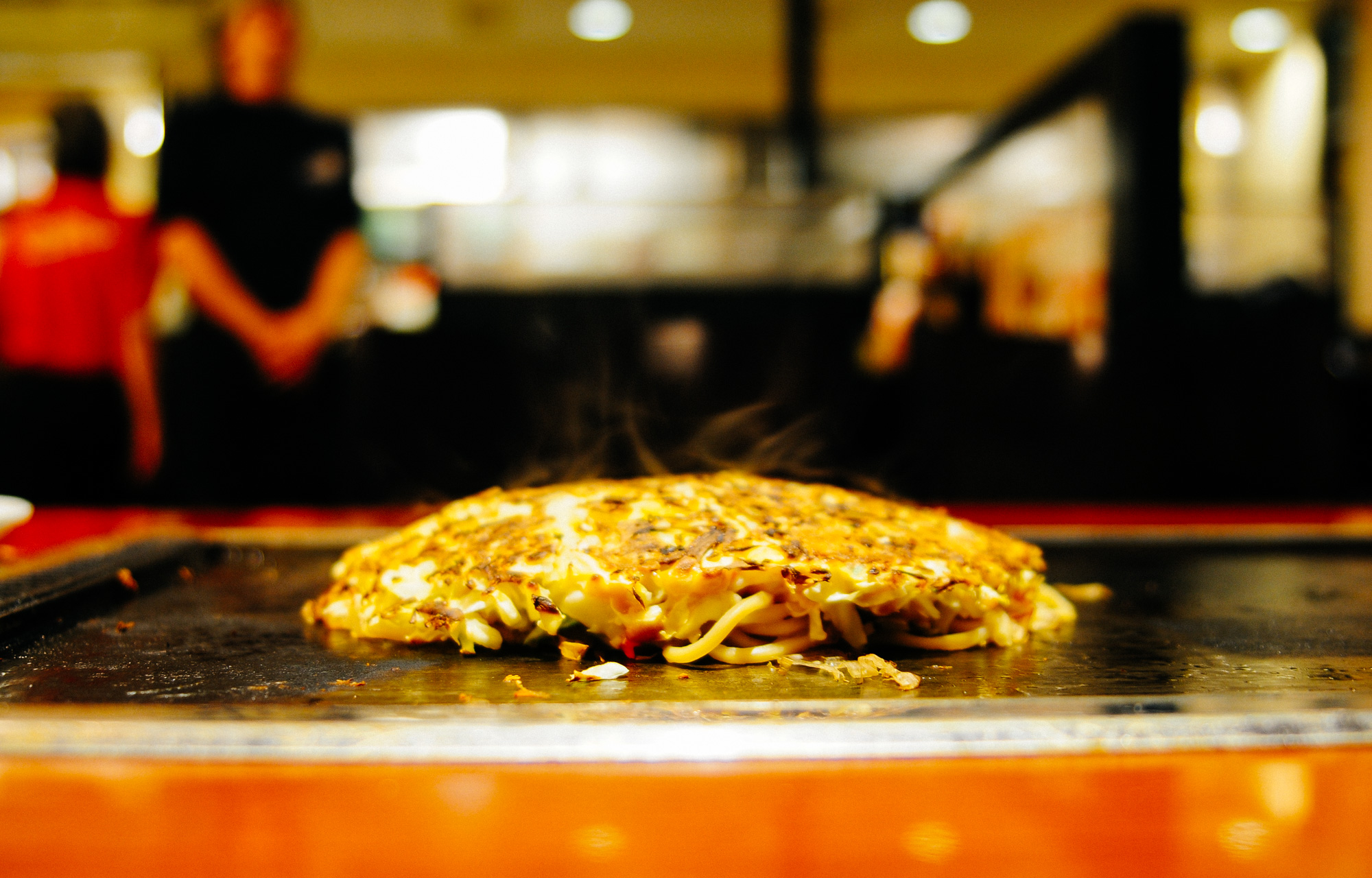The okonomiyaki is sometimes called the Japanese pizza or crepe. I tell you it tastes nothing like a pizza or crepe.