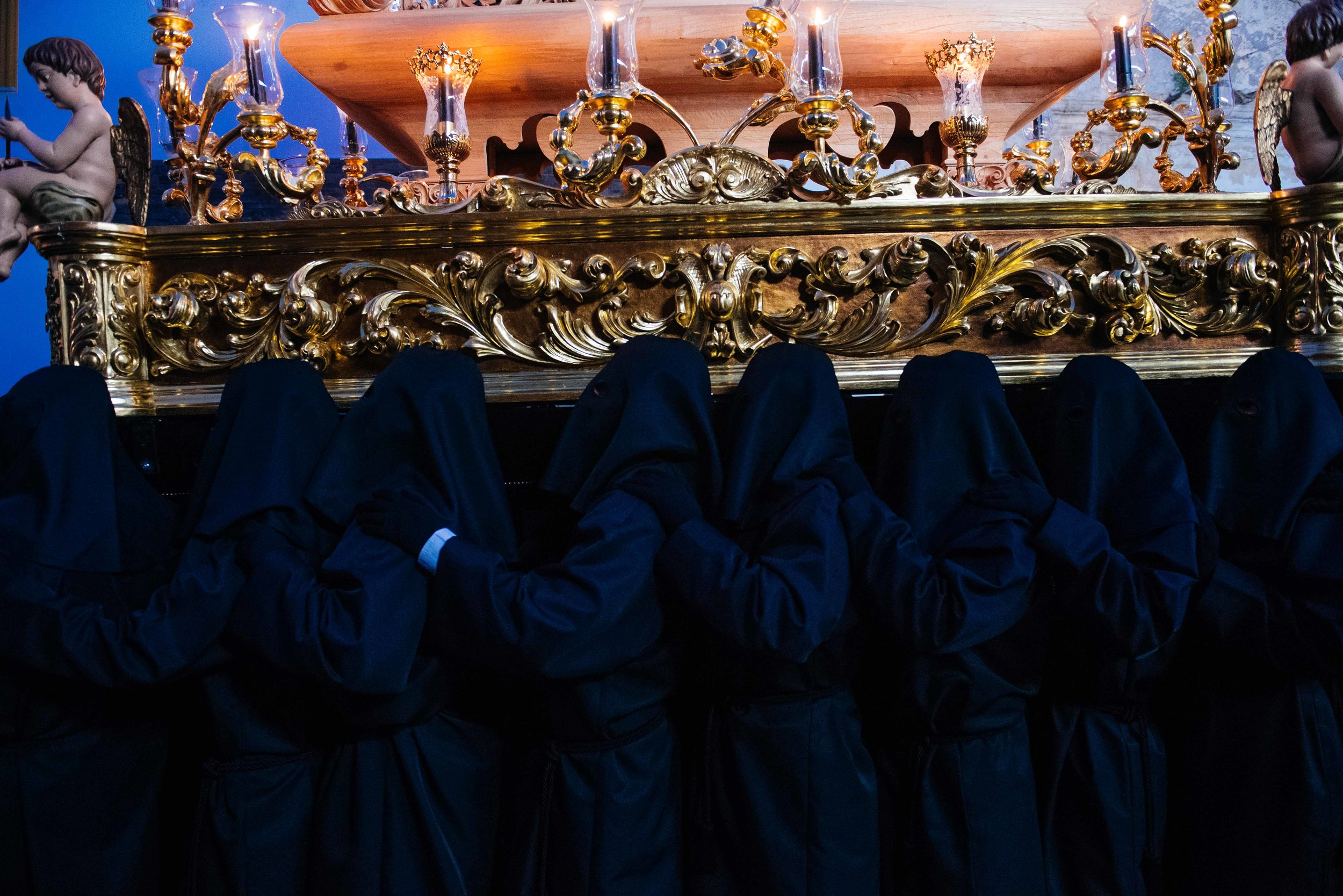 Costaleros wear black clothing and hoods to seem invisible at night so the image of Christ appears to be floating on the streets.