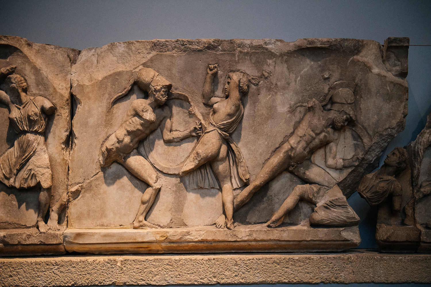 The engravings show different battle scenes of the Amazonomachy. In one of them, not this one, Hecules can be seen grabbing queen Hippolyta by the hair. Unfortunately I missed that slab.