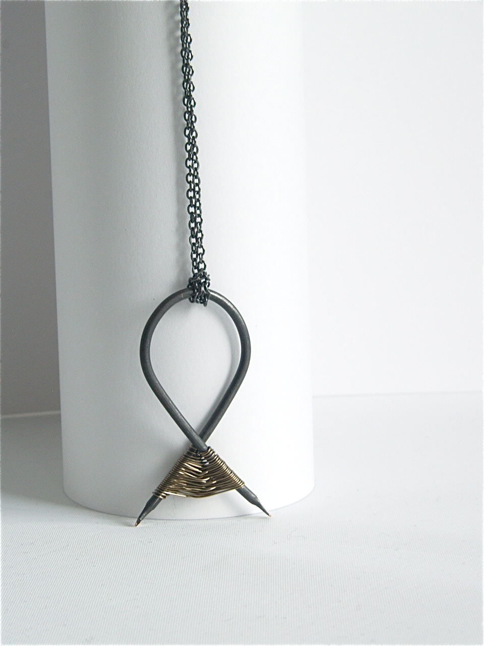 Oxidised silver plated pendant with gunmetal weave detail. £65