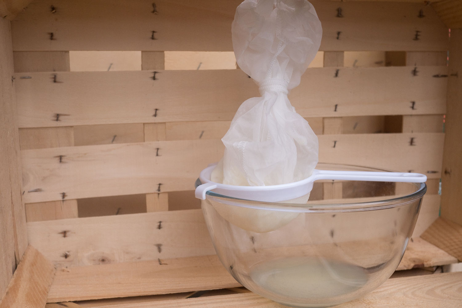 4. Pour the ready-made milk kefir into a cheesecloth lined sieve hanging over a bowl. Tie it up and place it in the fridge overnight. You will be left with whey, the liquid at the bottom of the bowl.