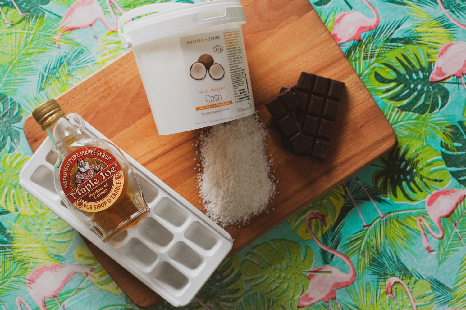 Four ingredients: Shredded coconut, dark chocolate, maple syrup, coconut oil.