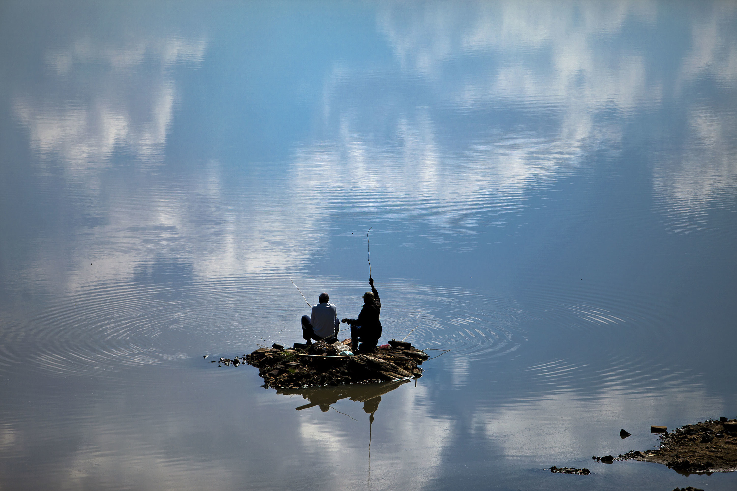 Fishermen at a lake in Limpopo, South Africa.