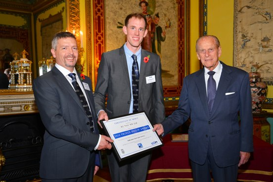His Royal Highness presents the Certificate of Merit to XL Vets: left, Stuart Gough, Calweton Veterinary Group and Dan Humphries, Lambert Leonard and May