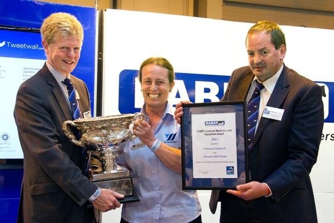 Gill Dickson receives the RABDF Livestock Machinery and Equipment Award from left, RABDF president, Prof David Leaver and Council member, Angus Wielkopolski