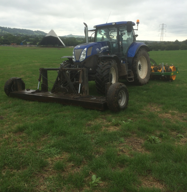 The tractor magnet with aerator following behind.