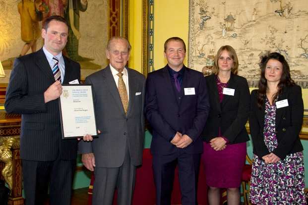 His Royal Highness presents the RABDF HRH Prince Philip Award to DeLaval's Kieran FitzGerald, with right, Joanna FitzGerald and Peter and Sheila Cox who manage a 130 cow herd at Stoke Climsland, Cornwall and were the first producers to install Herd Navigator.