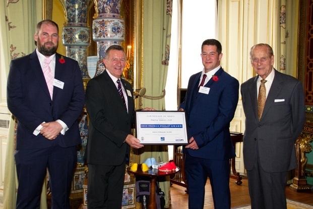 His Royal Highness presents the RABDF HRH Prince Philip Certificate of Merit to Dairy Spares' Jeff Radnor with left, Moover Orthopaedic Cow Shoe designers, Michael Brimble and hoof trimmer, Robert Todd.