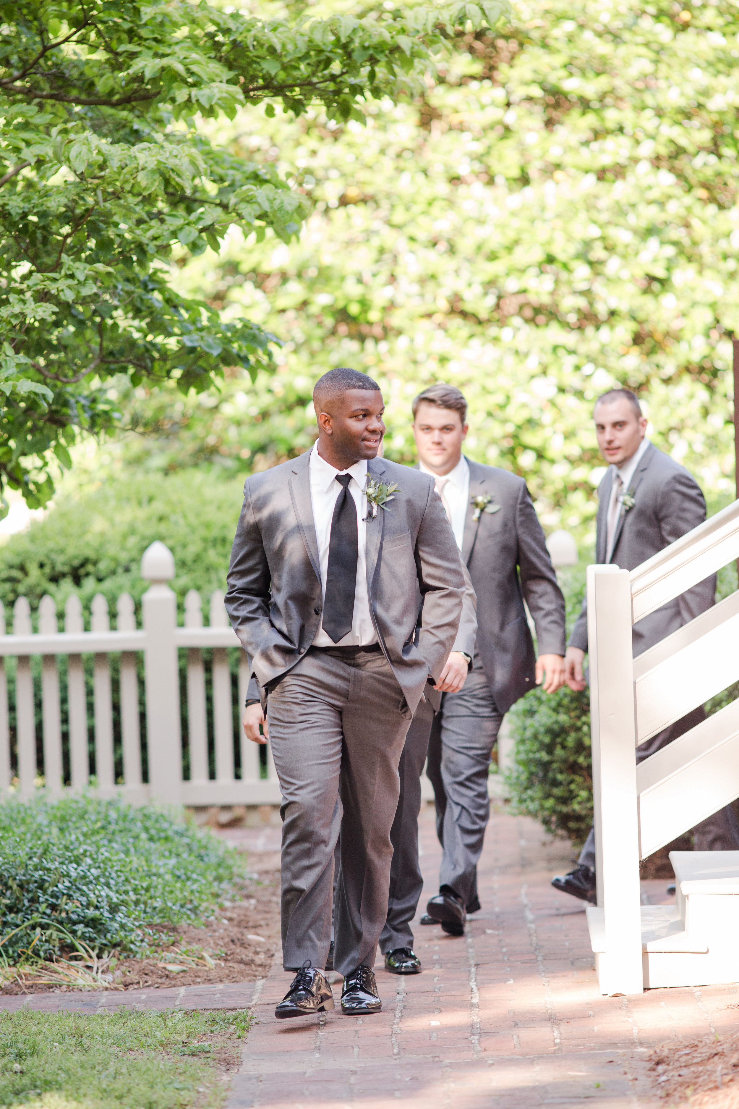 The groom makes his entrance to the ceremony from the Tavern.