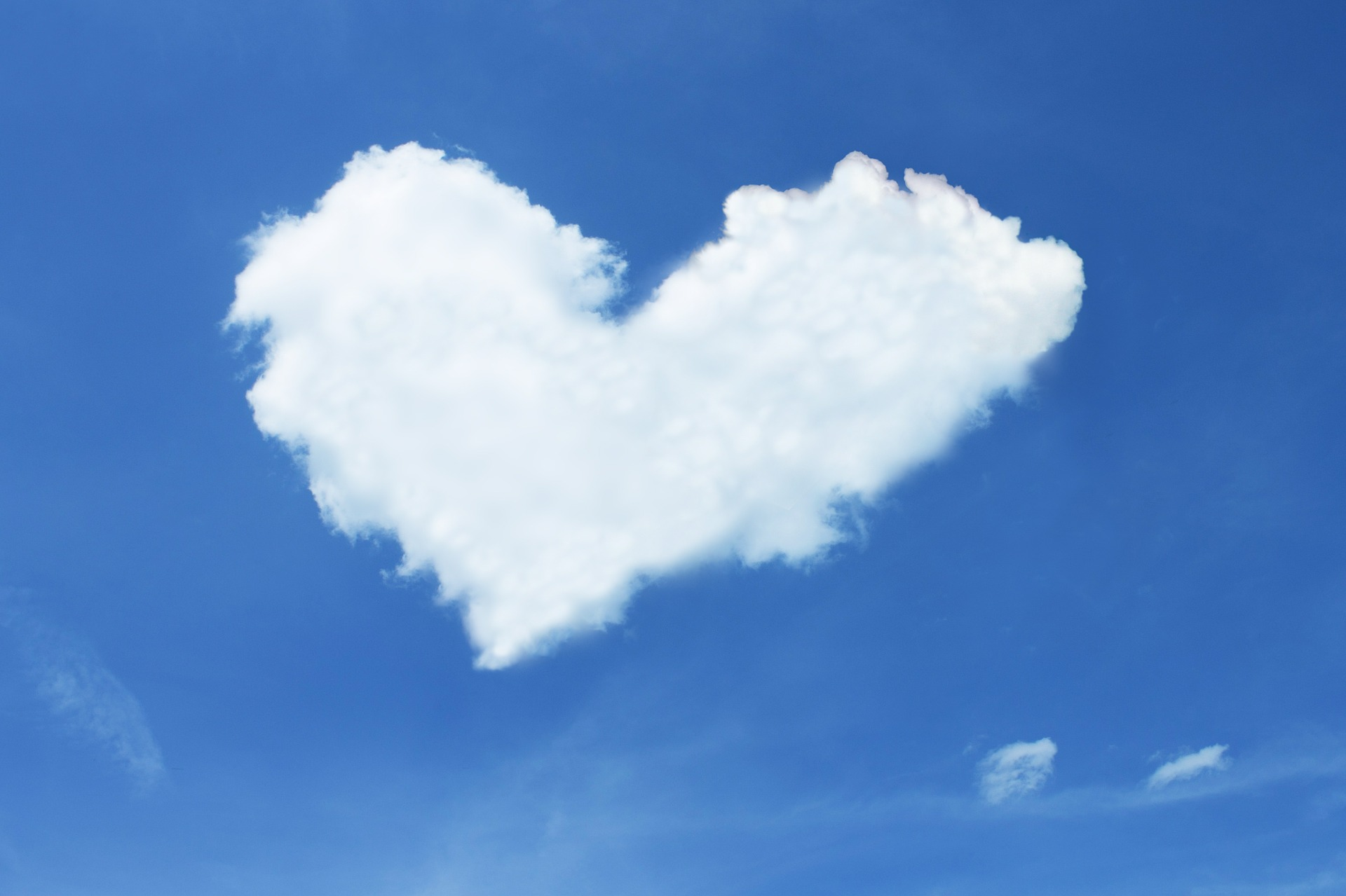 A heart shaped cloud in the sky