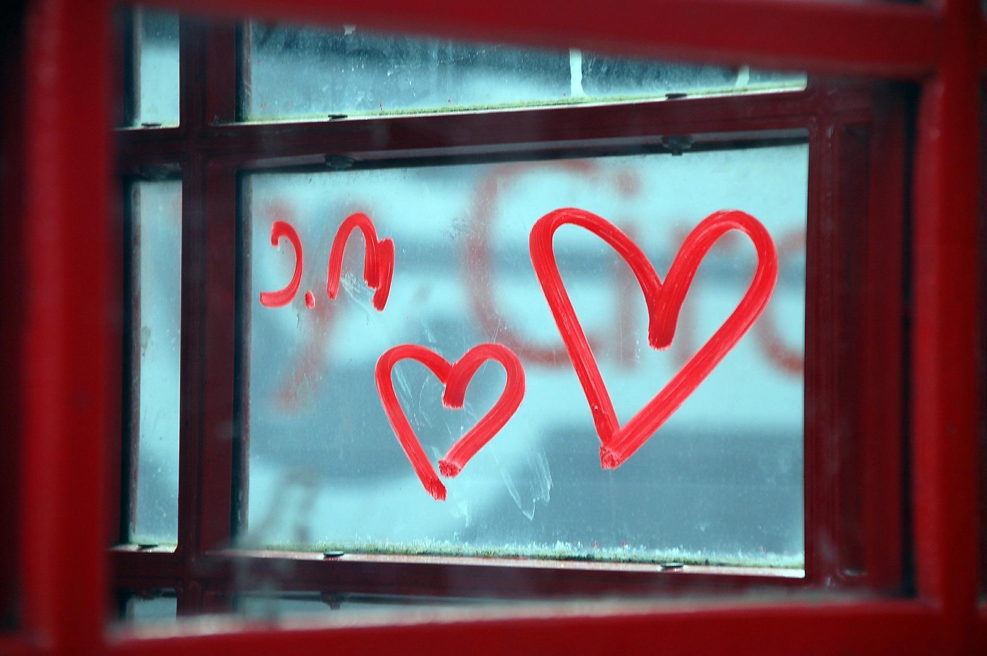 Lipstick hearts on a phone box