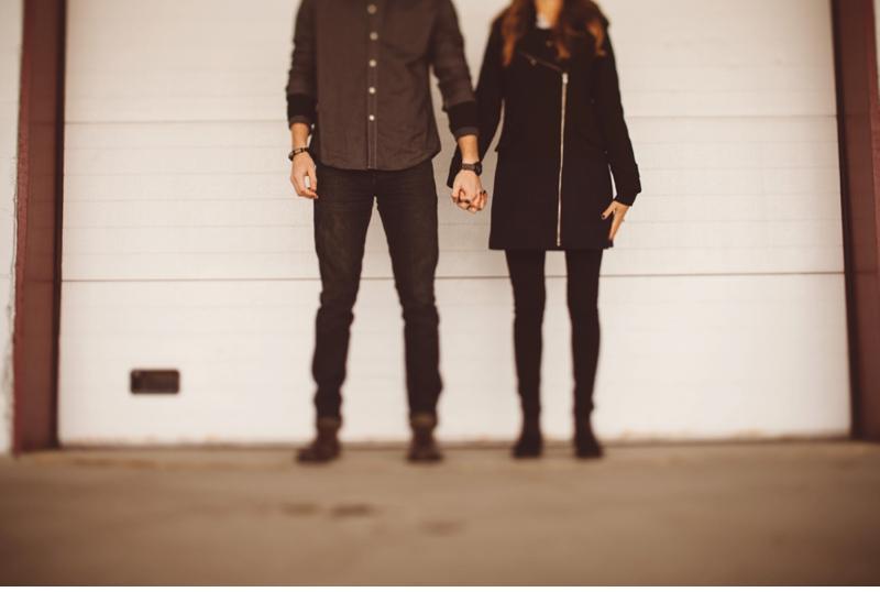 parking garage engagement holding hands