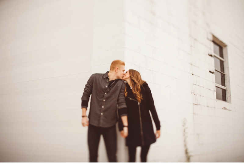kissing couple by wall bourbonnais