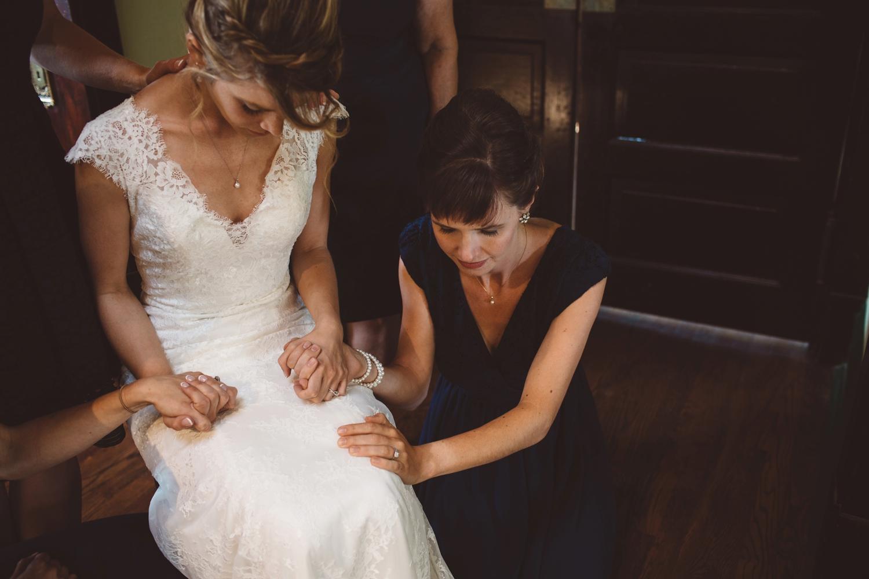 pre ceremony prayer with bride