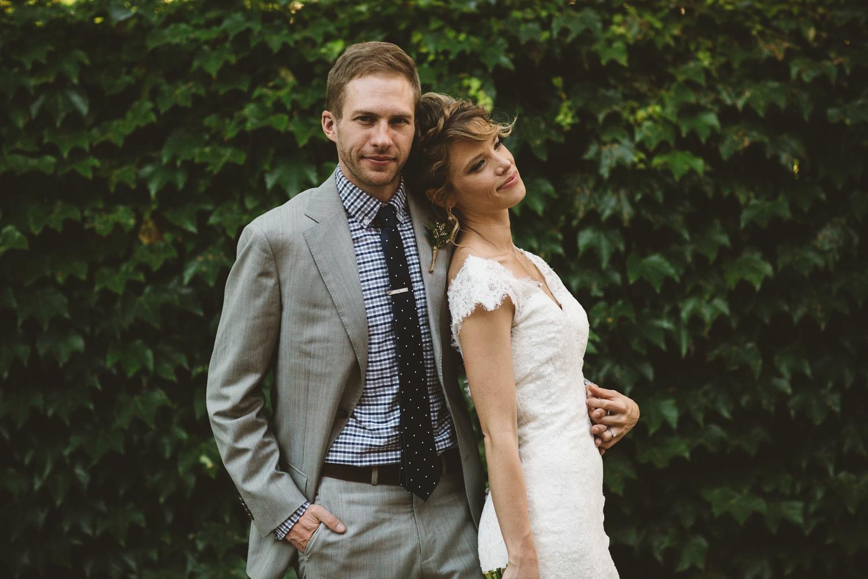 bride and groom in vines