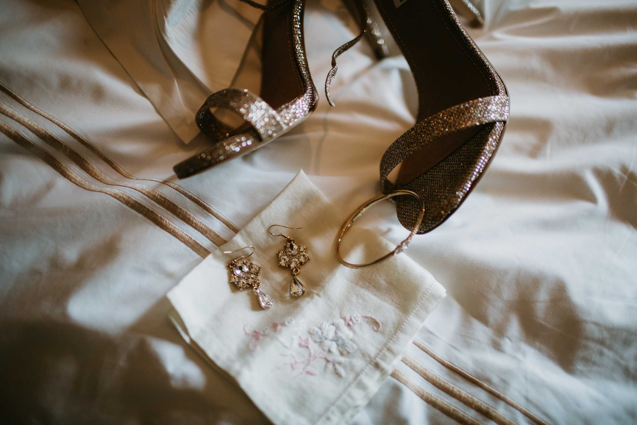 gold bridal shoes and earrings